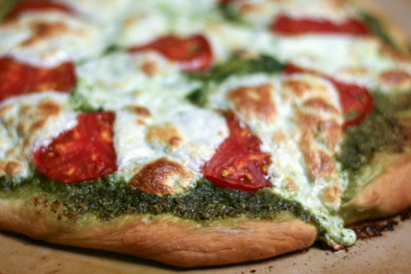 ... roasted tomato onion and basil pesto pizza with vegan parmesan cheese